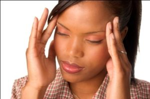 Woman with chronic headache, Migraine